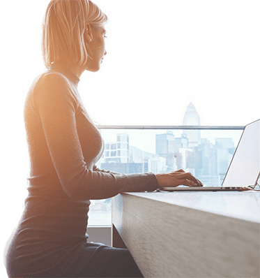 Woman on PC visiting Digital Marketing page on Full Stack Marketing Consultants website